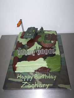 Camo cake - My son's 5th birthday party was Army themed, so I did the best camo icing I could.  The kids loved it, the cake was camo inside, too.  Thanks for looking.