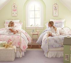 Purple and Pink shared bedroom.  green walls, white woodwork.