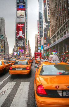 """Visit Times Square in NYC. [Photo """"Lovely Chaos @ New York City by Vinoth Chander.]"""