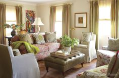 A medley of pinks and greens brings harmony to the living room. The desk behind the sofa unfolds to become a dining table, and the painting behind it is by the homeowner.