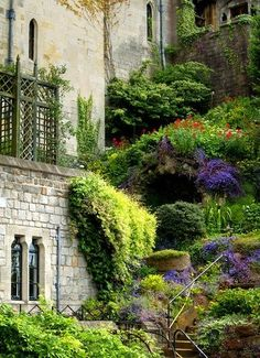 At my Summer Castle on the Continent.  (NOT!) More beautiful hillside garden ideas.  Look closely, there's a GROTTO up there in the middle... where you can drink your Tea/Wine/Jamba Juice, in the Summer heat.