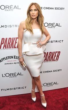 Jennifer Lopez embraces the winter white trend at a New York screening of Parker in a figure-hugging Lanvin peplum dress. She accessorizes with the French fashion house's ankle strap heels and gold trimmed clutch.