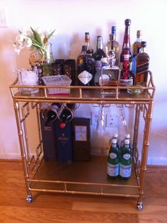 A much beloved bar cart from society social done up with some great vintage bar utensils/glasses/accouterments from etsy.