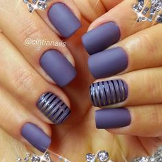 matte nail art and stripes... Almost like a dark periwinkle color... Blue violet but not quote indigo with black and silver stripes