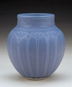 This wheel-thrown porcelain vase was carefully incised and fired to Cone 10 in reduction, by Ann Selberg. Looks like it could be 100 years old!