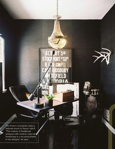Dark walls makes everything pop, like the chandelier and antlers