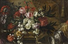 Atelier de Jean-Baptiste MONNOYER (1636-1699)  Bouquet de fleurs dans une jardinière fixée sur un entablement.  Huile sur toile, rentoilée.  64 x 100 cm