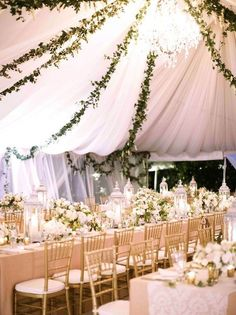 White tent + decor with greenery garlands