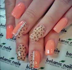 Nice peachy nails with print and rhinestones.