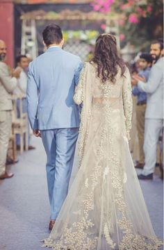 Sabyasachi bride - Indian bride - groom- trail -Indian wedding - cape- regal - saree - net - sheer