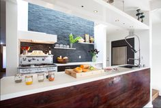 Old Bernal House- Feldman Architects. Reclaimed wood from the garage to use on the island/counter? I love this look. White, wood, slate, O'Keefe and Merrit stove.