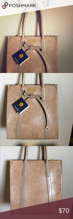 """NEW LISTING Designer """"Shopper"""" Large Tote with gold tone hardware and Accessorized front bow. An elegant versatile fashion statement. Color is more of a darker tan light mocha color, BEAUTIFUL! Price is firm unless bundled. Adrienne Vittadini Bags Totes"""