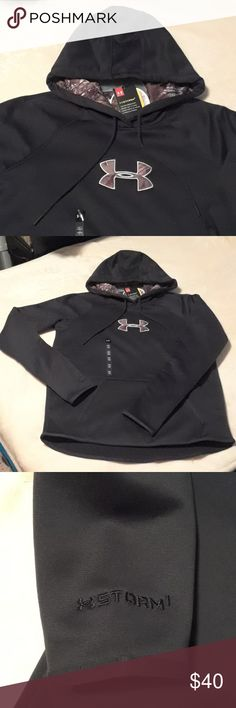 Women's Under Armour Hooded Sweatshirt Sz.SM/P/CH New with tags.Durable water repellant finish keeps you dry and light.Cold Gear fabric traps heat and wicks sweat to keep you warm,dry and light. Hooded sweatshirt. Color Black. Size SM/P/CH. Storm Armour Fleece keeps you warm and dry .Has a quick drying smooth outer layer.Has front pocket.Feel free to ask me some questions.  Non-smoking environment. Thank you for checking my listings! Happy Poshing😁 Under Armour Tops Sweatshirts & Hoodies
