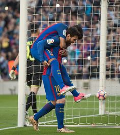 Lionel Messi of FC Barcelona celebrates with Neymar after scoring his team's 3rd goal from the penalty spot during of the La Liga match between FC Barcelona and Villarreal CF at Camp Nou stadium on May 6, 2017 in Barcelona, Catalonia.