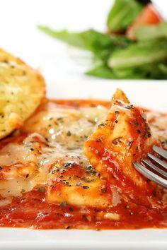 Recipe including course(s): Entrée; and ingredients: cheese ravioli, mozzarella cheese, spaghetti  sauce