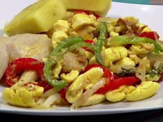 Ackee and saltfish, the national dish of Jamaica, is a delicious and popular breakfast food. Often accompanied by green banana and fried dumplings, Jamaican Cuisine, Jamaican Dishes, Jamaican Recipes, Salt Fish Recipe Jamaican, Oxtail Recipes, Carribean Food, Caribbean Recipes, Fish Recipes, Indian Food Recipes