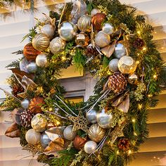 to make an outdoor wreath stand out and look good in front of large windows - Lowes Christmas Wreaths