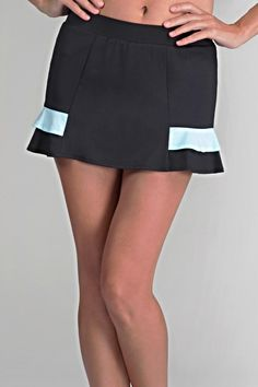 "This ladies tennis skirt is black with seafoam. It has built in shorties. The length is 12.5 "". It has a UPF rating of 50. The skirt is meant for tennis but can be paired with a tee shirt for a cute mini.  Ladies Tennis Skirt by Tail Tennis. Clothing - Activewear Florida"