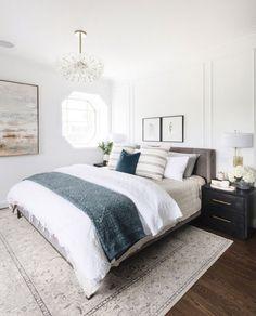 Neutral Master Bedroom, Rug Under Bed, Dark Nightstands With Brass Bar Pull.