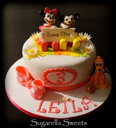 Cute fondant cake with Mickey mouse, Minnie mouse and pluto.