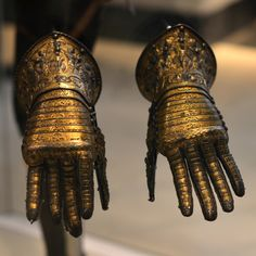 Steel gauntlets damascened with gold, c. 1585, Italy. At the Victoria & Albert Museum, London.  Probably presented as part of a set of armour to the future King Philip III of Spain by Charles Emmanuel I, Duke of Savoy.