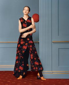 Wearing red during the holiday party season is a bit expected, but a floral print adds surprise. Celine jumpsuit, $6,000, (212) 535-3703. Loewe shoes, $1,090. (Photo: Jamie Hawkesworth. Styled by Joe McKenna)
