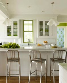 Pretty apple green accents in this #kitchen and I love seeing the wallpaper in the adjoining room!    Photographer:  Eric Piasecki    Source: Katie Ridder Rooms (2011 The Vendome Press) by Heather Smith MacIsaac, available through Amazon.ca.  Designer: Katie Ridder
