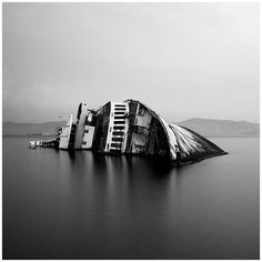 """""""Very clean. Clear blacks and greys, not a lot of whites. Looks like it's cut in half which is really nice subject. Sinking ship, makes me feel sad, abandoned and lonely. Left to go down and never be seen again. The water is calm and the photograph is flat without the other half of the ship."""""""