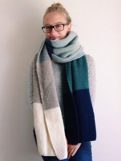 Cozy! Hand knit extra long and wide color block scarf. Perfect to wear as a scarf or wrap. 100% wool. 80 long, 17 wide. Hand wash, lay flat to dry.