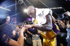 Kobe Bryant fist-bumps his daughter Gianna after the last NBA basketball game of…