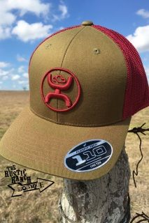 "Two tone Olive and Maroon Trucker Classic mesh back Maroon HOOey ""Hands-Up"" logo on the front Maroon Snapback closure One size fits all6 Time World Champion Cody Ohl Signature Ha. The ""O"" around the ""Hands-Up"" logo stands for Ohl."