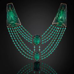 The Beetle necklace... by Rene Lalique c.1905, A salute to Egypt in gold, enamel and moulded glass with two larger green glass beetles backed with silver foil and mounted on yellow gold and two further moulded glass beetles held with black enamel claws.