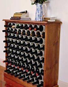 Use PVC pipes to separate your wine in an awesome wine rack.