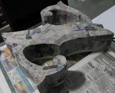 papier mache letters. Ive done this wiht 150 students at a time. Awesome project!