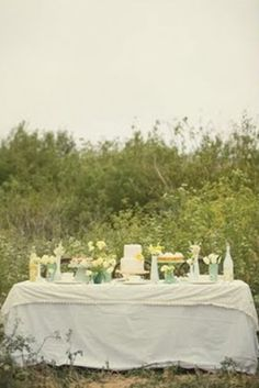 White table in the meadow by louellaa
