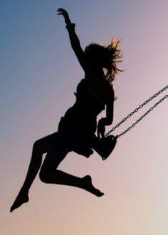 Wow,she is having fun. I love swinging,too.