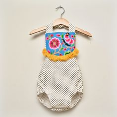 Boho polka dotted romper with Hmong hilltribe embroidered bib and mustard tassel trim.