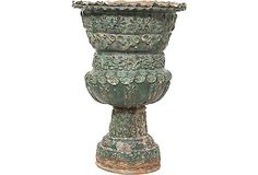Green Terracotta Urn-Green glazed on terracotta-colored pottery, with bias-relief motifs-Jack Deamer, JED-$875.00, Retail $1,250.00. This would look great on my patio, or even in my bedroom or living room. Actually, I could find a place for it anywhere in my home...