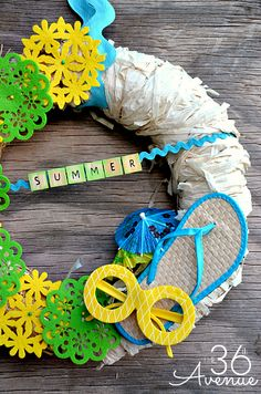 Summer Wreath Tutorial... Such a fun wreath! Made with Dollar Store items!!!