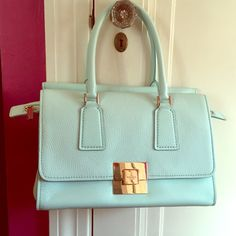 Party Sale!Kate Spade Amelia Street Joana Soft, luxurious saffiano leather in Cloud, a crisp minty blue. Gold hardware including flip lock that reveals a secret pocket! Pretty top handle satchel. I have only carried this bag twice and still have the tags. Inside is super roomy, and the outside is so beautiful I can't stop staring at it! Dust bag and original tags included.  kate spade Bags Satchels