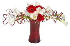 A colorful matte red Gathering vase is the perfect vessel for these white tulips and gerbera flowers accented with OASIS Decorative Wires.