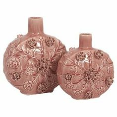 """Set of 2 ceramic vases with a textured floral motif.   Product: Small and large vaseConstruction Material: CeramicColor: Blushing pinkFeatures: Three dimensional applique detailsDimensions: Small: 10"""" H x 9"""" W x 5"""" DLarge: 12"""" H x 11"""" W x 7"""" D"""