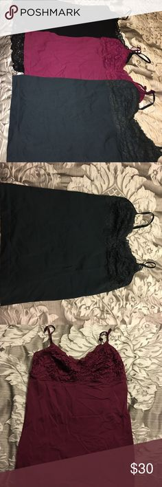 Lot of 3 Cami Form Fitting Tanks The cranberry and deep green tanks are from Banana Republic - have adjustable silky straps. In perfect condition. Maybe worn twice each. The black tank was worn probably 5 times and is from Express. Has built in shelf bra- good condition! Perfect for laying under dressy tops for the holidays. Banana Republic Tops Camisoles