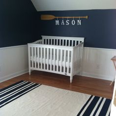 nautical nursery with paddle (hang pictures from paddle instead of letters)