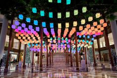 A view of the David Rockwell's installation Luminaries looking toward the grand stair in the Winter Garden.
