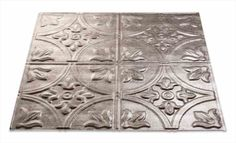 This Fasade 2x2 lay-in ceiling tile in Traditional 2 is a larger version of our Traditional 1 design and depicts square and circle patterns punctuated with elegant floral shapes. Our Crosshatch Silver finish is graceful and cool-toned. This appealing, distressed finish can be used in almost any style of decor and is a favorite of designers.