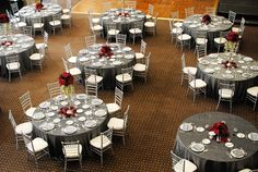 Table Settings: gray tablecloth and centerpieces.