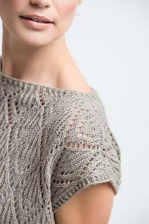 The Monterey Tee features a beautiful allover twisted-rib lace motif; the simple construction allows you to focus on the rhythmic pattern. Style this top with a simple camisole or layer it over long sleeves for transitional seasons. This tee is worked from the bottom up in pieces and then blocked to allow the openwork to bloom.