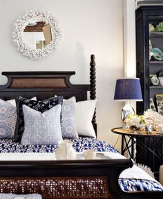 Dark wood and light blue and navy prints in the bedroom.