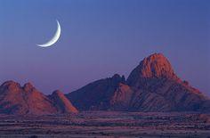 Crescent Moon over Spitzkoppe, Damaraland, Namibia_ Africa